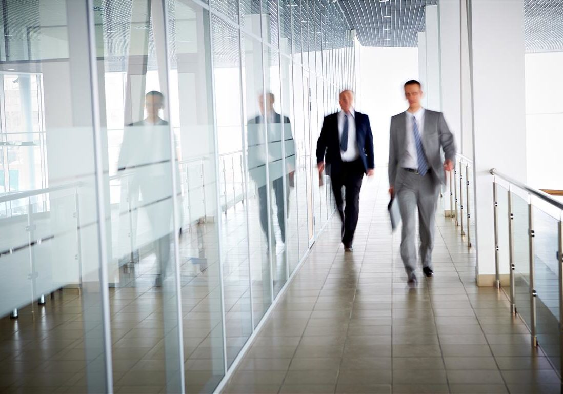 businessmen-walking-in-corridor